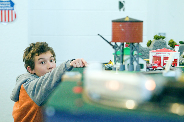 Record-Eagle/Jan-Michael Stump<br /> Neo Marks, 11, of Frankfort pushes a button to make a train move during the Festival of Trains at the Crooked Tree Art Center - Traverse City. The event, hosted by the Northern Michigan Railroad Club of Traverse City and Great Lakes Children's Museum, began in 1991. It is open daily through Dec 31.