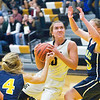 Record-Eagle/Jan-Michael Stump<br /> Glen Lake's Jennifer LaCross (10) drives between Cadillac's Molly Anderson (4) and Chloe Fessler (23) in the first quarter of Tuesday's game.