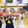 Record-Eagle/Jan-Michael Stump<br /> Cadillac's Molly Anderson (4) tries to avoid getting trapped by Glen Lake's Savannah Peplinski (24) and Jennifer LaCross (10) in the first quarter of Tuesday's game.