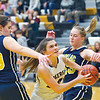 Record-Eagle/Jan-Michael Stump<br /> Glen Lake's Savannah Peplinski (24) drives between Cadillac's Emmaline Rosenburg (30) and Chloe Fessler (23) in the second quarter of Tuesday's game.