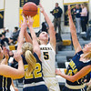 Record-Eagle/Jan-Michael Stump<br /> Cadillac's Allie McAllister (40), Katie Bartman (22) and Kallie Poulos (10) try to defend a shot by Glen Lake's Hailey Helling (5) in the first quarter of Tuesday's game.