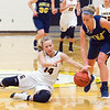 Record-Eagle/Jan-Michael Stump<br /> Glen Lake's Lily Ewing (14) slides to grab a loose ball tipped from Cadillac's Kallie Poulos (10) in the first quarter of Tuesday's game.