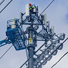 Record-Eagle/Jan-Michael Stump<br /> Luther Shoots of C and J Services audits a Verizon cell tower at Thirlby Field in Traverse City on Tuesday afternoon. The audit involves measuring the space on top to see how much equipment it can hold.