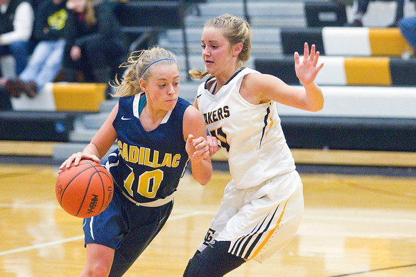 Record-Eagle/Jan-Michael Stump<br /> Glen Lake's Allie Bonzelet (11) defends Cadillac's  Kallie Poulos (10) in the third quarter of Tuesday's game.