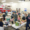 Record-Eagle/Jan-Michael Stump<br /> Members of the Traverse City Fire Department and over 40 volunteers wrap presents inside Fire Station 1 on Saturday morning. The annual tradition, which will help about 200 children from Grand Traverse County this Christmas, dates back to the late 1940s when firefighters would repair toys for local children in need. The program now collects donations from local businesses, schools and community members, as well as from Toys for Tots.