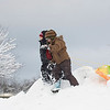 Record-Eagle/Keith King<br /> Kevin Hubbell, left, 6, of Honor, and Katherine Hopkins, 9, of Traverse City, prepare to go sledding Thursday at the Grand Traverse County Civic Center.
