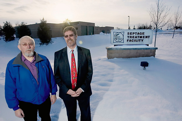 Record-Eagle/Keith King<br /> Glen Lile, left, East Bay Township supervisor, and Chuck Korn, Garfield Township supervisor, stand at the septage treatment facility in Traverse City.