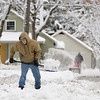 Record-Eagle/Keith King<br /> Tom Jach, of Traverse City, shovels the end of his driveway Thursday.