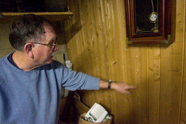 Record-Eagle/Keith King<br /> Walt Lentz, of Honor, points out a line on the wall of his home where a height measurement was taken of his grandson, Jordan Lentz, years ago.