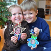 Record-Eagle/Vanessa McCray<br /> Annette,left, who turns 3 this month, and brother Gilman, 5, Piche show their favorite ornaments bearing their own photographs.