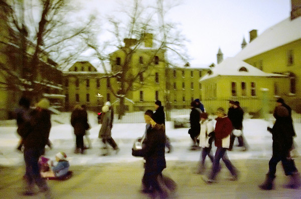 "Record-Eagle/Keith King<br /> Participants in the international event called ""Unsilent Night"" stroll on the grounds of the Grand Traverse Commons in Traverse City on Friday. Event-goers started at Left Foot Charley's, which hosted the event. They carried boom boxes, each making a different sound, to create a musical sound sculpture. The event is modeled on the one created by composer Phil Kline, who debuted the first ""Unsilent Night"" in New York in 1992."