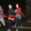 Record-Eagle/Garret Leiva<br /> Runners jog down Front Street Sunday evening during the fourth annual Jingle Bell 5K. The non-competitive run wound through downtown Traverse City, starting and ending at the Park Place Hotel. Instead of a timing chip, however, runners wore jingle bells tied to their shoes and clothes. Jingle Bell participants also donated non-perishable food items to benefit Goodwill Industries of Northern Michigan. The annual run was sponsored by the Traverse City Track Club.