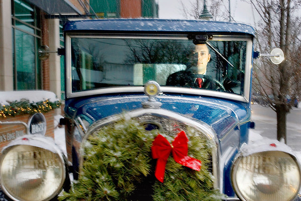 Record-Eagle/Keith King<br /> Jonathan Klinger, of Traverse City, sits Tuesday in the 1930 Ford Model A Tudor Sedan he has been driving.