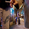 Record-Eagle/Keith King<br /> Smokers stand along Union Street in downtown Traverse City.