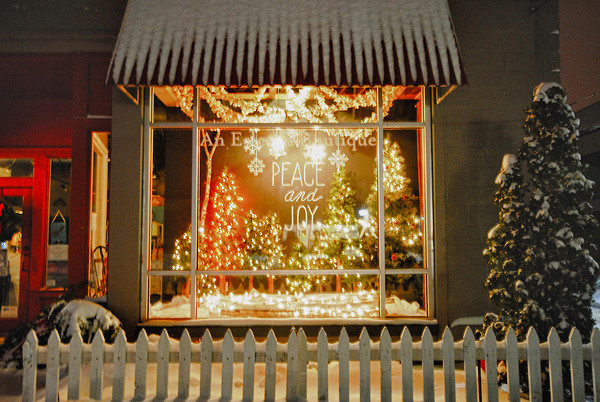 Record-Eagle/Dan Nielsen<br /> A window at The Red Dresser on Hall Street is decorated with a holiday message.