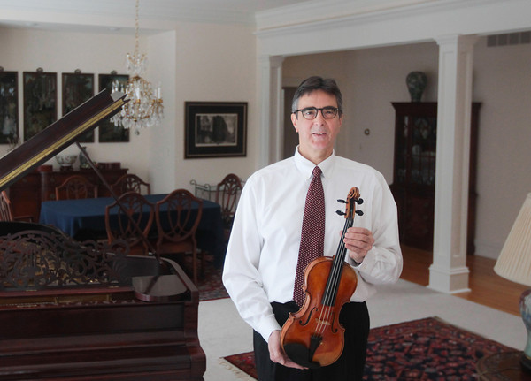 "Record-Eagle/Keith King<br /> Jim Bruno, of Old Mission Peninsula, holds a 2001 Ada Quaranta violin Thursday which is a copy of a Guarneri del Gesu ""Kreisler"" violin."