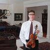 "Record-Eagle/Keith King<br /> Jim Bruno, of Old Mission Peninsula, holds a 2001 Ada Quaranta violin Thursday which is a copy of a Guarneri del Gesu ""Kreisler"" violin."