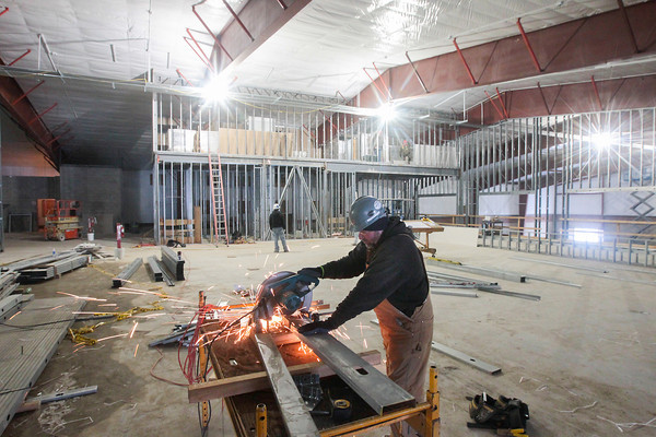 Record-Eagle/Keith King<br /> Mark Burton, with Chess Construction, cuts metal studs Thursday as work takes place on the new YMCA building in Traverse City.