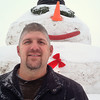 Record-Eagle/Nathan Payne<br /> Brad Culver stood in front of a 25-foot-tall snowman he constructed alongside his friend Dirk Alpers last week. The men decided to make the monument to the season to spread a little Christmas cheer, he said.