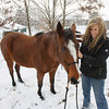 Record-Eagle/Keith King<br /> Michelle Smith, of Boardman Township, stands with her horse, Lil' Bit, Saturday, December 22, 2012 after Smith adopted the horse from Dana Round.