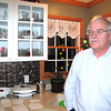 Record-Eagle/Glenn Puit<br /> William Crawford, former director of the Benzie-Leelanau District Health Department, stands in the kitchen of his Frankfort home on Dec. 18, 2012. Crawford was demoted because of a sexual harassment allegation, but Crawford said the allegation is not true. He wants his job back and a public retraction.