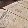 Record-Eagle/Keith King<br /> Editions of the Traverse City Record-Eagle from the 1920s lie on table Friday, December 14, 2012 in Traverse City. The newspapers were found by Aaron Grenchik, of Williamsburg, while he was working at a house on West 9th Street in Traverse City.