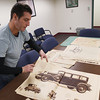 Record-Eagle/Keith King<br /> Aaron Grenchik, of Williamsburg, talks about and shows newspapers Friday, December 14, 2012 from the 1920s that he found while working at a house on West 9th Street in Traverse City.
