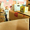 Jan-Michael Stump<br /> Phoebe Walter, 6, builds a box tower during Boxing Day party at Right Brain Brewery in Traverse City, which provided large and small boxes and encouraged people to bring their own to create and have fun. Boxing Day, a national holiday in the United Kingdom, Ireland, Canada and other former British colonies, has roots are in an old British tradition of the wealthy giving boxes of gifts to their servants the day after Christmas, as well as the Christian church's distribution of donations to the poor in celebration of St. Stephen's Day.