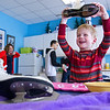 Record-Eagle/Jan-Michael Stump<br /> Leland Nowak, 6, of Traverse City reacts after using an ice skate blade to cut an ice cube while spending part of his birthday at Thursday's Freeze Fest at the Great Lakes Children's Museum in Traverse City, which featured hands-on educational activities with snow and ice.
