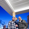 Record-Eagle/Jan-Michael Stump<br /> Eric Smith and his1 year-old son Fletcher stand with Dan Brady outside the Smith's new home in Traverse City's Depot Neighborhood, a net-zero home that Brady helped raise money to build.