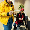 """Record-Eagle/Keith King<br /> Fred Schaafsma, left, and Tami Stagman, both of Traverse City and members of the Cherry Capital Cycling Club, place """"Your Safety Matters"""" stickers on LED taillights at the Goodwill Inn."""