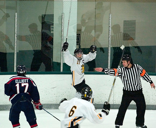 Record-Eagle/Jan-Michael Stump<br /> Traverse City Central defenseman Kyle Froese (17) celebrates his second period goal against the Bay Reps Monday at Centre ICE Arena.