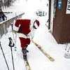 Record-Eagle/Keith King<br /> Santa Claus prepares to go telemark skiing on Schuss Mountain at Shanty Creek Resorts Saturday, December 25, 2010 during the Ski Free with Santa event.