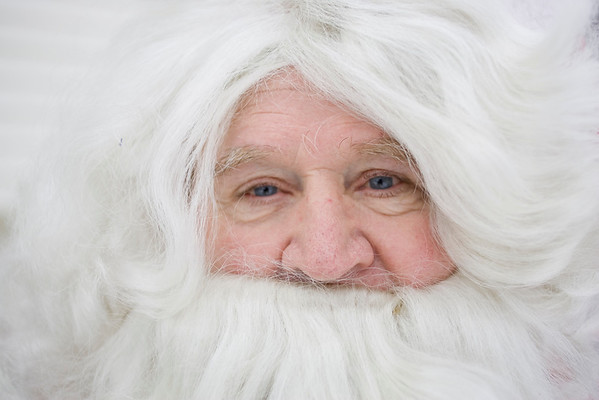 Record-Eagle/Keith King<br /> Ellis Olson, of Traverse City, dresses up as Santa Claus, which he's done for more than 50 years.