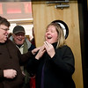 "Record-Eagle/Jan-Michael Stump<br /> Filmmaker Michael Moore, left, tells Katie Myers (cq) of Traverse City she is the 500,000 visitor to the State Theatre on Wednesday, arriving with her father Frank Wolfinger (cq)(back center) to see a 1:30 p.m. showing of ""The King's Speech."" Myers received a lifetime pass to the theatre as well as a gift basket from downtown businesses."
