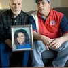 Record-Eagle/Keith King<br /> <br /> Lyle Sutton, left, and Tedd Strieter, both of Traverse City, sit with a photo of their sister, Shari Marvin, Wednesday, November 3, 2010.