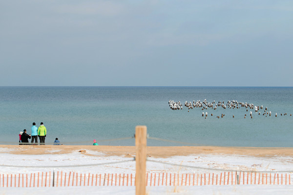 Record-Eagle/Keith King<br /> Pilings and Lake Michigan are visited Saturday in Glen Haven.