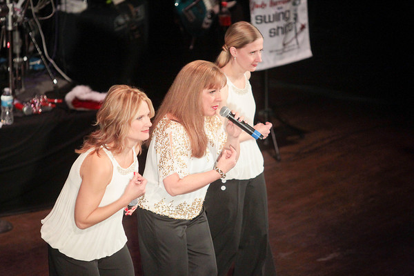 Record-Eagle/Keith King<br /> Judy Harrison, middle, sings Friday during the SwingShift and the Stars Dance-off for Charity at the City Opera House in Traverse City.