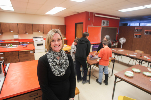 Record-Eagle/Keith King<br /> Amy Burk, executive director of the Communities In Schools of Mancelona after-school program, stands in a class at Mancelona Middle School as an enrichment program is participated in as part of the program.