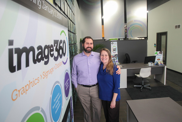 Record-Eagle/Keith King<br /> Andrew and Amy Kohlmann, owners, stand Thursday at their business, image360.