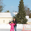 Record-Eagle/Keith King<br /> Mandy McIntyre, of Grand Rapids, ice skates with her daughter, Ava McIntyre, 7, Saturday in Suttons Bay. McIntyre grew up in Suttons Bay.