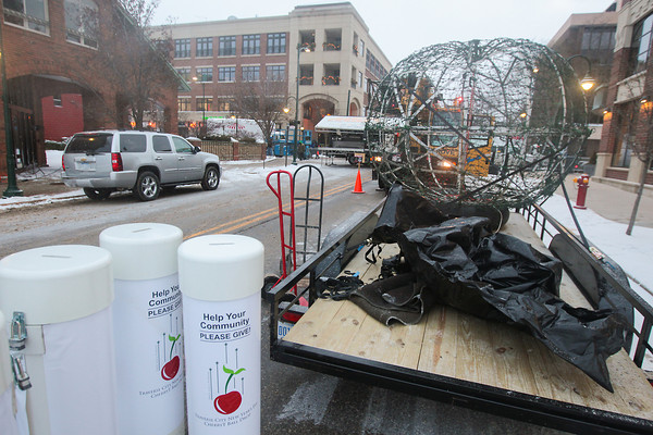 Record-Eagle/Keith King<br /> Preparations are made for the Traverse City New Year's Eve CherryT Ball Drop at the intersection of Front Street and Park Street.