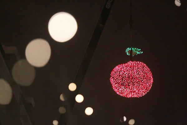 Record-Eagle/Keith King<br /> The illuminated cherry hangs during the New Year's Eve CherryT Ball Drop celebration in downtown Traverse City.