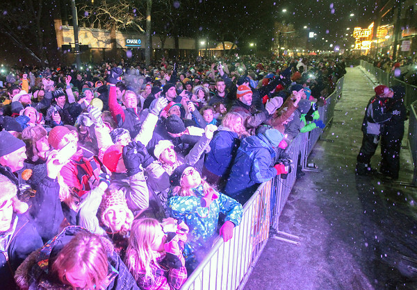 Record-Eagle/Keith King<br /> People celebrate at midnight during the CherryT Ball Drop in downtown Traverse City.