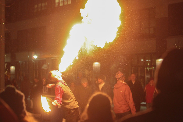 Record-Eagle/Keith King<br /> Trevor Babiarz, of Traverse City, performs a fire-breathing act during the New Year's Eve CherryT Ball Drop celebration in downtown Traverse City.