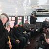 Record-Eagle/Keith King<br /> John O'Brien, owner, tells jokes to passengers while sweeping Friday aboard a Celtic Shuttle and Tours bus in Traverse City.