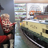 Record-Eagle/Michael Walton Ron Vanderhulst, of Kalkaksa, and his granddaughter watch a model train speed around a bend at the History Center of Traverse City's Festival of Trains.