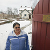 Record-Eagle/Keith King<br /> Kathie Scott, of Traverse City, stands in the backyard of her house Tuesday, January 1, 2013 along Division Street in Traverse City.