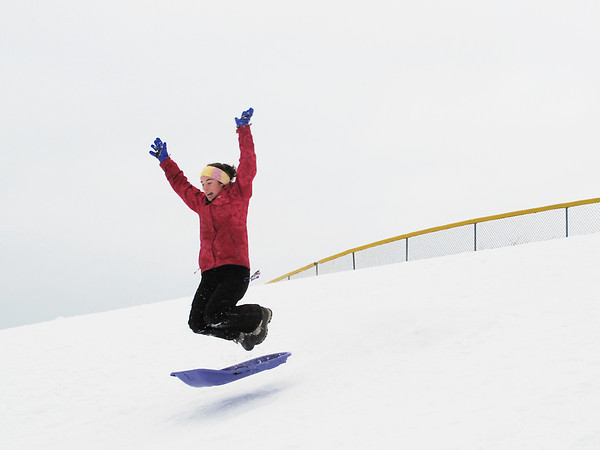 Record-Eagle Photo/Art Bukowski<br /> <br /> Eliza Lugten, 15, hits a jump on a sledding hill near Traverse City West Middle School Monday afternoon.