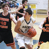 Record-Eagle/Keith King<br /> Traverse City St. Francis' Kody Kleinrichert (3) looks to shoot against Harbor Springs' Spencer Kloss (40) and Trevor Rohrer (20) Friday, January 4, 2013 at Traverse City St. Francis High School.